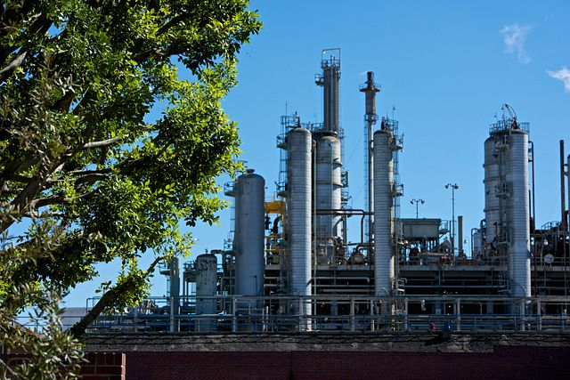Daytime shot of Los Angeles Refinery with tree in foreground